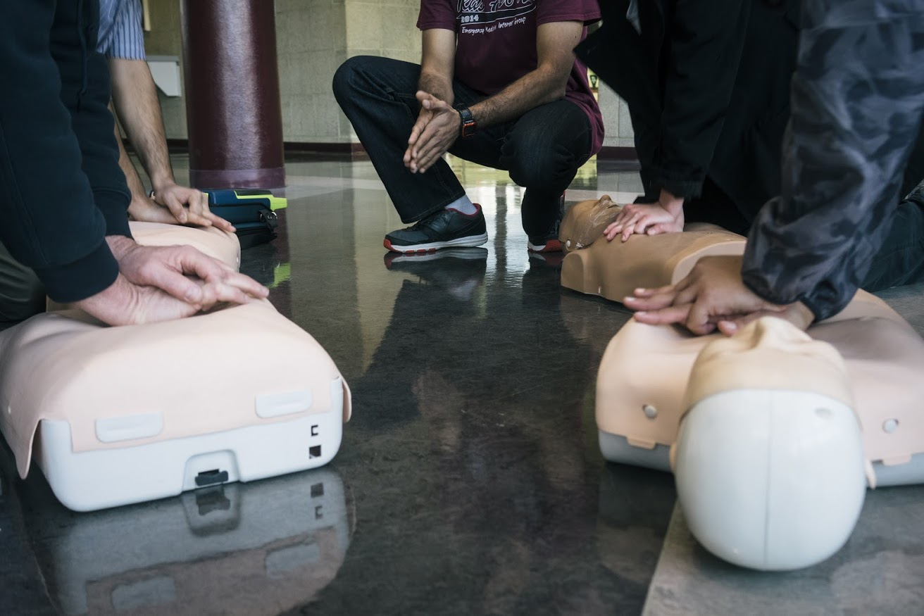 Mannequins, a space to practice, and helpful instruction were the keys to hands-only CPR training. (Photo by Jessica Nguyen)