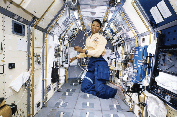Mae Jemison, MD, (a general practitioner) floats in zero gravity at the Spacelab Japan Science module aboard STS-105, Endeavour.