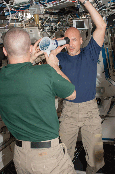Astronaut Luca Parmitano collects fundoscopic images with the help of astronaut Chris Cassidy for the Ocular Health experiment.